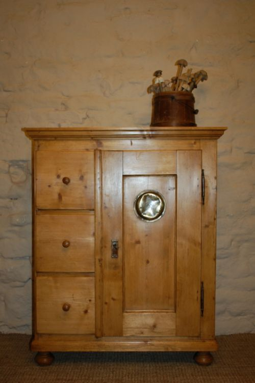antique pine storage cupboard with bank of drawers