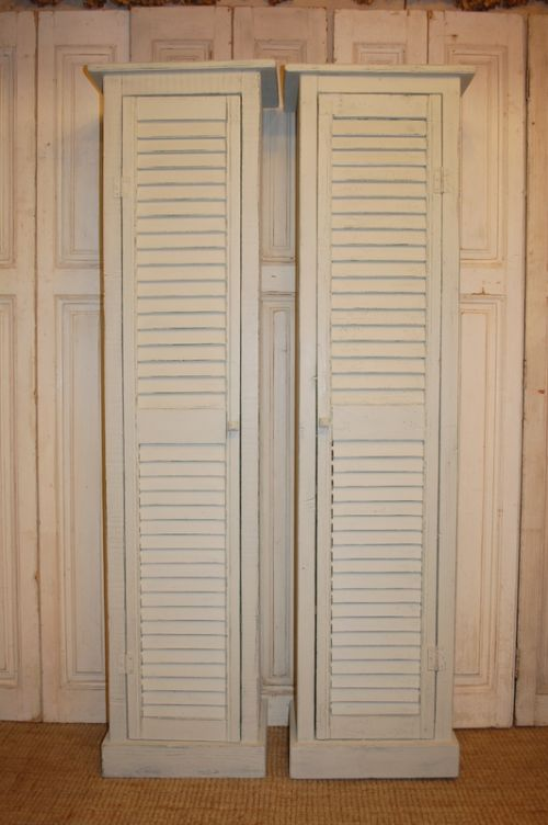 pair of rustic vintage french shutter cupboards