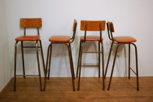 set of four vintage tall stacking bar stools