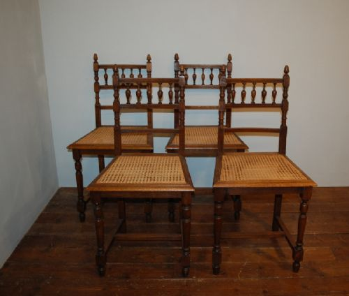 antique set of four matching french oak and bergere dining kitchen chairs 1900