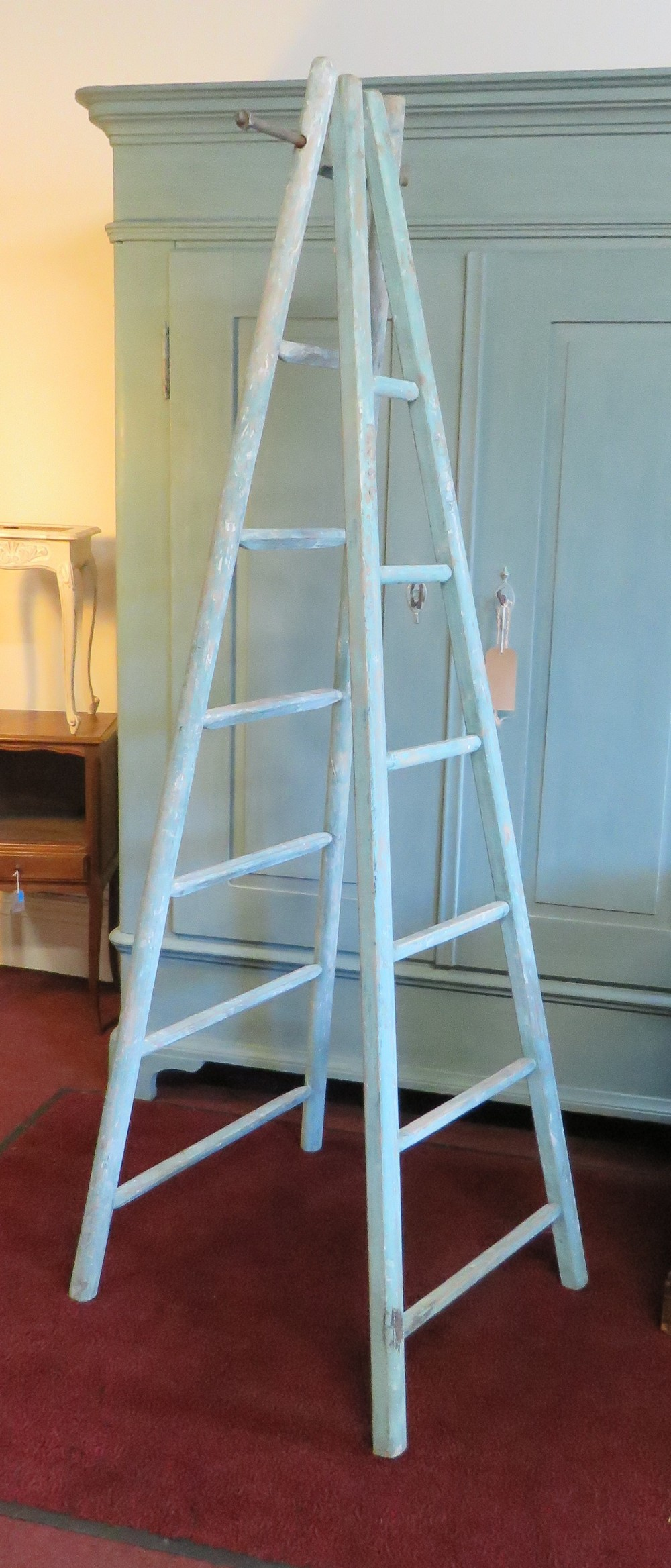 antique set of french fruit picking ladders in old distressed paint
